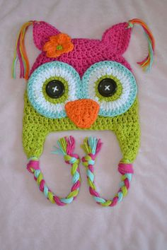Owl hat-gotta find buttons! love this one! the pink and green are very popular together, love the blue on the eyes!