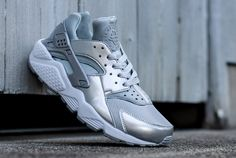 The latest Nike WMNS Air Huarache features a Metallic Silver upper along with a white midsole.