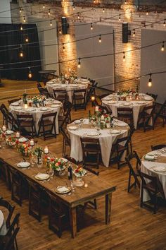 Love the exposed wood farm tables for the wedding parties with round tables for guests!