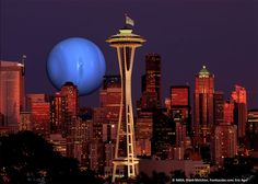 This image, adapted by Eric Agol of the UW, depicts the view one might have of a rising Kepler-36c (represented by a NASA image of Neptune) if Seattle (shown in a skyline photograph by Frank Melchior, frankacaba.com) were placed on the surface of Kepler-36b.