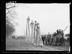 "weirdvintage: ""The Sloan family performing on stilts en route to a rehearsal of Bertram Mills Circus, photo by George Woodbine, 1932 (via National Media Museum UK/The Daily Herald Archive) """