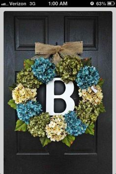 I like initial in the middle idea, different flowers for the wreath