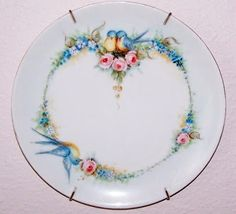 Antique, turn of the century porcelain plate with handpainted bluebirds. Gorgeous!