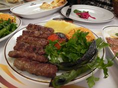 Köfte, minced lamb meatballs with herbs, often including parsley and mint, on a stick, grilled, is a form of Iran or Turkey Kebab.