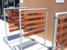 FA16672- Wayfinding and Directional Wooden Signs Hung from a Steel Frame