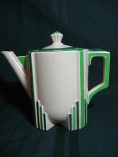 Doulton deco: unnamed earthenware tea pot, D5211, c1932 (pattern). Toned green highlights on Pillar shape with straight lines and stepped feet.
