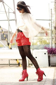 Black pantyhose with criss-cross pattern and dots, red heels and skirt and transparent white