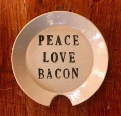"""Peace, Love and Bacon..... Locally thrown, painted and glazed by Thomas """"Bud"""" Skupniewitz. 6"""" diameter; Food safe;"""