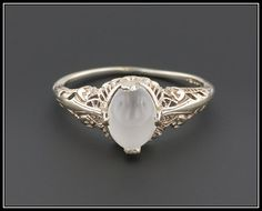 Hey, I found this really awesome Etsy listing at https://www.etsy.com/listing/265828685/vintage-moonstone-filigree-ring-14k-gold