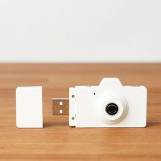 Cool, micro camera with built in USB plug. Great for quick shots on the go. (1280x1024 picture resolution and 16GB capacity).