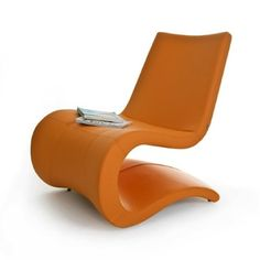 lounge chair | orange | modern | unique | office | seating area | waiting room | hotel | lobby | lounge | restaurant | bar | interior design | commercial interior design | contemporary | flowing