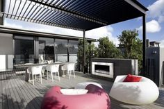 trendsideas.com: architecture, kitchen and bathroom design: On the beach – new house by Lindy Leuschke Again great out door decking and fireplace