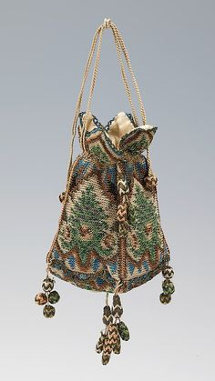 Reticule - silk and metal - 1800–1810, probably German - in the Metropolitan Museum of Art costume collections. Check out all those little baubles!