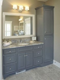 Traditional Bathroom Design, Pictures, Remodel, Decor and Ideas - page Relocate linen cabinet. Add slim pullout cabinet (w/electrical sockets for blow dryer, etc. Adjust countertop for double sinks. Maybe 4 drawers instead of Dream vanity! Rustic Bathroom Vanities, Bathroom Renos, Vanity Bathroom, Linen Cabinet In Bathroom, Bathroom Fixtures, Bathroom Lighting, Small Bathroom Cabinets, Restroom Cabinets, Bathroom Gray