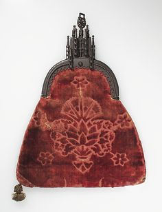Purse Date: Late 15th century Culture: Northern European Medium: iron, red velvet brocade. From the collections of the Metropolitan Museum of Art.