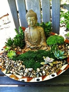 Large ceramic bowl with moss, succulents, and Buddha statue. Perfect as a garden accent.