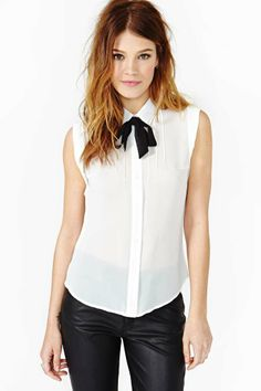 Bonjour Blouse by Nasty Gal. Simply love this. I have so many pullover sweater that would look great with this. The bow adds an extra chic touch.