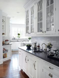 Soapstone with white tile backsplash, although this is marble tiles. White cabinets. Could you do another cabinet color?