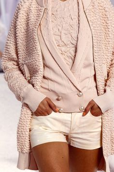 Chanel is hot ... blush pink shorts with layered blouse, vest, and jacket