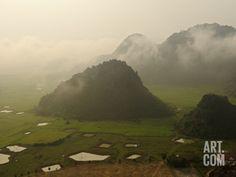 Mist Sweeps Past the Hills of Phong Nha Ke Bang National Park Photographic Print by Carsten Peter at Art.com