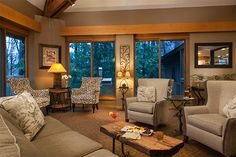 Common space with views of the woods (and a fireplace!) around the Inn at Honey Run