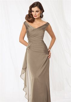 Shown in Bronze…Draped bodice with off shoulder neckline. Fluted skirt with side flounce and beaded accent. Available in tea and floor lengths. Mother of the bride dress