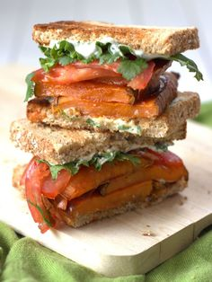 This hearty vegan club sandwich is made with slabs of roasted sweet potatoes and cilantro lime cashew mayo.