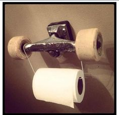 Old skateboard DIY- love this as hook idea for Coles room. Minus the TP :)