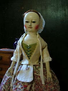 Reproduction English Wooden Queen Anne Dolls and Izannah Walker Dolls : Prudence is carrying some of her small possessio...
