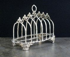 A Victorian six division silver toast rack,