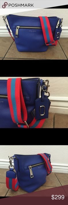 """NWT! Marc Jacobs Gotham City Crossbody Bucket Bag New with tags! 100% Authentic! Gorgeous cobalt blue leather, adjustable fabric strap, leather tag, 4 metal feet on the bottom, interior zipper pocket, magnetic top closure. Measures approx.  12""""W X 5.5""""D X 9""""H. Marc by Marc Jacobs Bags Crossbody Bags"""