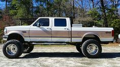 "1997 F-250 7.3 Powerstroke on 38x15.50's on 20x14"" American Forces Owner: @slaughterk94 #blue_oval_obsession"