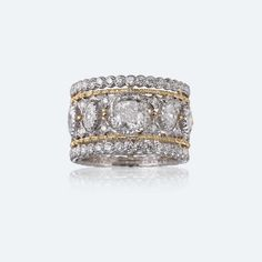 Buccellati Band ring with white and yellow gold and diamonds. https://facebook.com/DiamondDreamFineJewelers https://twitter.com/Diamond_Dream_ https://instagram.com/diamonddreamjewelers