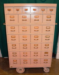 1960s steel card catalog on casters from a GM office in Indianapolis, IN. Perfect for a hipster living room. :)