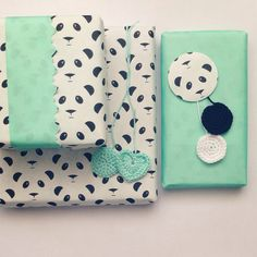 Quirky panda gift wrap. Love the contrasting turquoise washi tape.