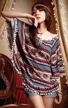 Inspired by woven Aztec fabrics, Odetta Aztec Print Cape is the perfect way to work color and pattern into your look. The white ball fringe trim gives this piece a signature bohemian spin - wear it with flared pants and a fringed shoulder bag for a '70s-style outfit.