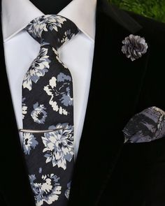 201ceaaffd Bold florals with touchs of grey to soften the look. A sleek sterling  silver tusk tie bar only enhances the drama.
