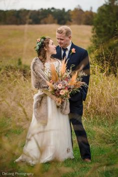"Are you a bohemian bride? See all kinds of dazzling bohemian wedding inspiration photographed at Carolina Country Weddings! This nature inspired wedding venue is located in Maiden, NC. The bride chose to say ""I Do"" in front of a jaw-dropping pampas grass wedding arbor - you just have to see it! Continue through this pin to view their incredible day! #delongphotography #carolinacountryweddings #bohemianwedding #bohemianweddinginspiration #northcarolinaweddingvenues Autumn Bride, Autumn Wedding, Rustic Wedding, Bohemian Wedding Inspiration, Bohemian Bride, Nature Inspired Wedding, Wedding Planning On A Budget, Boho Wedding Decorations, Pampas Grass"