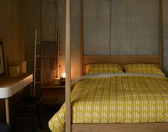 Ochre ikat-stripe duvet-set on the Hatfield 4 poster bed - all from Natural Bed Company