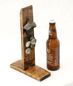 This unique barrel stave bottle opener eliminates the need for using 2 hands when popping the top off a bottled brew. Made from reclaimed oak wine barrel staves, and utilizing a mighty 'mortise and tenon' joint, this opener is rigid enough to provide anythirsty userwith the full strength of a standard wall opener. Best of all you can place it on any hard and flat surface so you can have the convenience of wall opener anywhere. The super strong magnetic catch will grab about a couplesix…