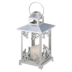 Iron-framed candle lantern with scrolling details and glass sides.  Product: LanternConstruction Material: Iron ...