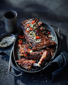 Coated in a glaze made from Chinese five-spice, honey and soy then charred on the barbecue or grill – serve these stickiest ever pork ribs for an eat-with-your-hands kind of dinner party.