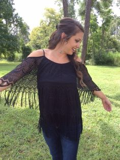 There is no other way than to mix fringe with Spring. This is one top that is a must! Black Fringe Layered Top.  Www.therhinestoneleopard.com
