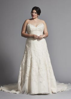 84641c79ac7 Strapless A-line beaded wedding dress with sweetheart neckline available in plus  size.