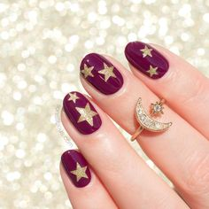 Elegant Christmas nails with golden stars