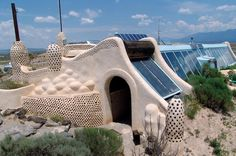 """Green living: Off the grid families pioneer sustainable energy lifestyles - CSMonitor.com  One of Mike Reynold's """"earthship"""" homes, off the grid homes built using grabage and local materials."""