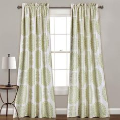 This curtain set enlivens the mood in any room with its soft tone colors and beautiful array of medallions