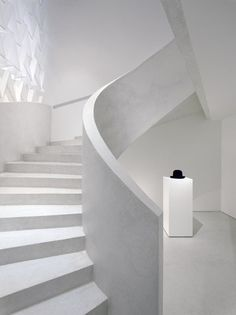 Staircase inside the Yohji Yamamoto flagship store in Paris by Sophie Hicks. Photo by Johannes Marburg.