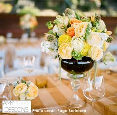 Love this look! Striped tablecloth, tall and short centerpiece, and colors are perfect for a rustic wedding. Lovely! #rustic Location Thomas Fogarty Winery