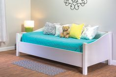 By day, this daybed provides a comfy place to sit. By night, or when needed for guests, it becomes a bed. Whichever purpose it's serving, this daybed looks great doing so. The curves add style, and the look can be masculine, feminine, or neutral, depending on the finish and bedding you choose.